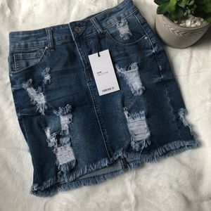 For every 21 distressed denim skirt